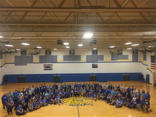 The Billings Wildcats stand in support of the Galena Bears in their time of loss.
